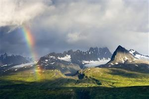 Amazing Rainbow in Snowy Mountain