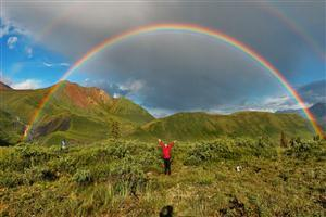 People Enjoy Natural Double Rainbows