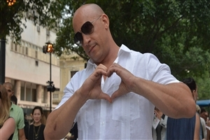Vin Diesel Give Heart Sign on Camera Photo