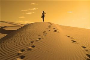 A Man Walking in Desert Wallpaper
